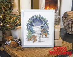 Shine bright! A frosty forest in stitches... Enjoy our classic scene with your fave woodland characters, enjoying the crisp, night air – shimmery fabric adds special sparkle, the easy way. Only in the new issue 221 of The World of Cross Stitching magazine