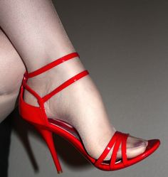 Red, strappy, high-heel sandals with sheer, nude pantyhose