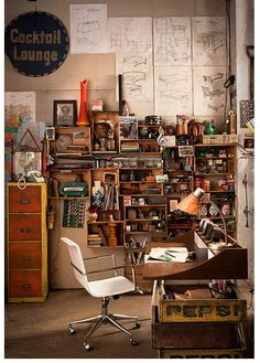 Love that desk and the mess of wooden boxes screwed to the wall.