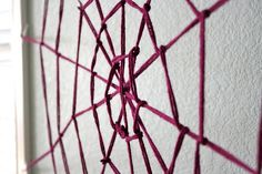 Spider web made from yarn.