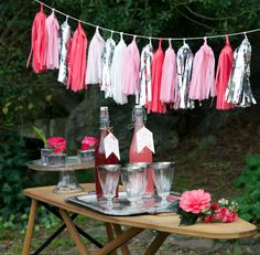 A drink station made easy with a vintage ironing board.