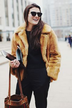 {late-autumn inspiration : warm wood and faux fur and shades of umber}