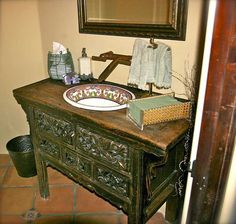 Ethnic vanity with Saltillo tile and Talavera insets.  Wonder if it would be possible to find a small piece like this to replace a pedestal sink in powder?