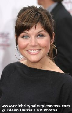 Tiffany Amber Thiessen bangs | Tiffani Thiessen with a trendy ponytail hairstyle