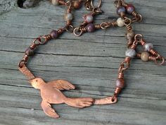 Artisan copper bird necklace, one of kind rustic, hand fabricated bird on a hand made copper wire wrapped chain with jasper stones by JoDeneMoneuseJewelry
