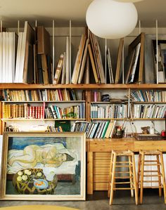 painting storage in the studio - combined with bookshelves on one wall