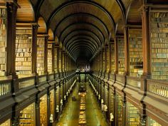 Old Library at Trinity College in Dublin. The Book of Kells is kept in this gorgeous library. <3