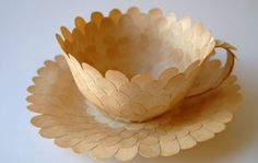 Cecilia Levy used recycled book pages and glue to make this series of pretty paper teacups.