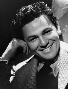 John Garfield (March 4, 1913 – May 21, 1952) was an American actor adept at playing brooding, rebellious, working-class characters. He grew up in poverty in Depression-era New York City and in the early 1930s became an important member of the Group Theater. In 1937, he moved to Hollywood, eventually becoming one of Warner Bros.' major stars.