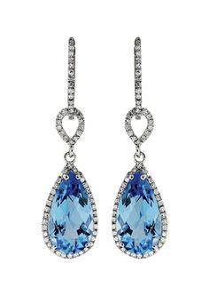 TWINKLE TOPAZ: Earrings in 14k white gold with 5.9 cts. t.w. blue topaz and 0.38 ct. t.w. diamonds; $1,750; EFFY Jewelry, NYC; 212-944-0020; effyjewelry.com