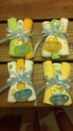 Baby boy corsages for mother/mother to be made from wash cloths!