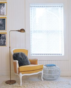 Yellow Chair  This warm yellow upholstered chair is a cozy spot in a largely white-washed room.