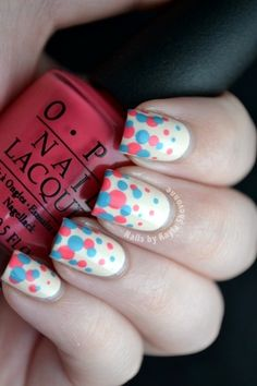 Multi-colored dotted nail art.