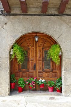 Image of 'Detail of the Facade of Spanish Homes Decorated with Flowers'