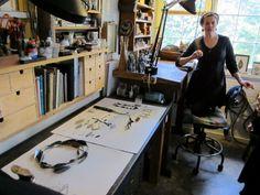 Lori Talcott in her studio with her cat.