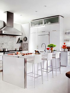 We love this classic white kitchen with a modern spin. More kitchen makeovers: http://www.bhg.com/kitchen/remodeling/makeover/before-and-after-kitchen-makeovers/?socsrc=bhgpin062213modernwhite=4