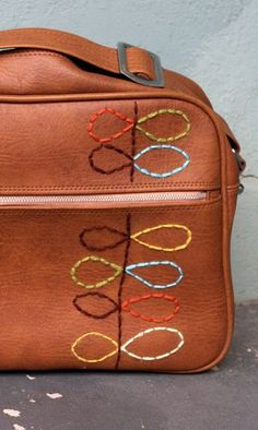 Orla Kiely Inspiration - a thrifted vinyl bag enhanced with hand stitching