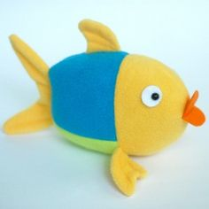 Fishy Stuffed Animal Pattern - You can make this free stuffed animal pattern in any color you would like, making it a great way to use up leftover scraps from other projects. Looking to make a baby-friendly stuffed animal pattern, just make this cute creation without any hard or button eyes to keep little ones safe.