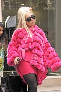 """Lady Gaga in her $24,000 Armani rabbit fur coat (confirmed real) a few days ago. Gaga, like the Kardashians, is fully aware of the gruesome process of skinning animals alive to make fur coats and still buys them. She wasn't """"born this way."""" She is just cruel this way. Disgusting, filthy bitch."""