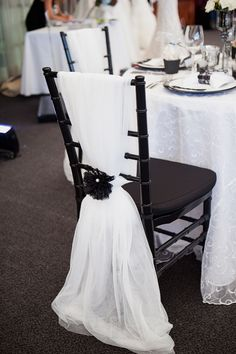 Easy chair back decor...tulle secured with flower.
