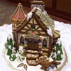This Christmas-themed cottage, created by Mary E. of Timonium, MD, is made from gingerbread, icing, candy rocks, and ice cream cone pine trees. | thisoldhouse.com