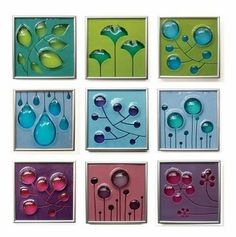 Colored glass tiles.  Would love these as the back splash in a Mid-Century kitchen!
