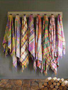 Beautiful row of pastel tartan throws.