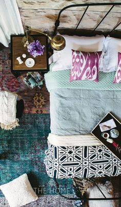 Beautiful bedroom. From above. Mixed patterns, textures. Boho chic.