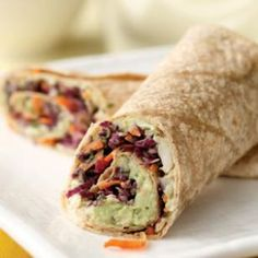 Creamy Avocado & White Bean Wrap ~ White beans mashed with ripe avocado and blended with sharp Cheddar and onion makes an incredibly rich, flavorful filling for this wrap. The tangy, spicy slaw adds crunch.
