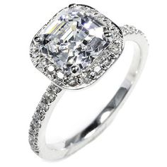OGI  1.5-carat Asscher-cut diamond and .4-total-carat-weight pave diamonds in 18kt white gold, OGI, price upon request; ogi-ltd.com.
