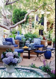 Blue and white vases and containers for an outdoor event lounge