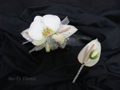 Wrist Corsage and matching Boutonniere featuring phaleonopsis orchids, mini anthurium and mini roses.