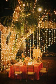 What a festive party the strands of lighting makes to this Patio. wedding receptions, tree, wedding lighting, dinners, dinner parties, patio, backyards, destination weddings, party lights