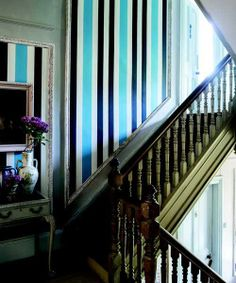 This bold blue stripe, done up in Farrow &  Ball Chromatic BP 4205, demands attention in a neutral stairway. | Photo: Courtesy of Farrow & Ball | thisoldhouse.com decor, balls, stripe stairway, stripe wallpap, blue striped wallpaper, stripes, blues, traditional homes, wallpaper patterns