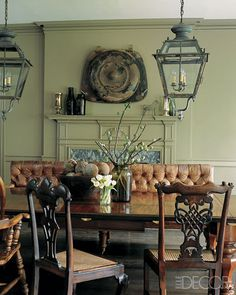 19th-Century street lanterns float above a mahogany table in this dining room curated by Glen Senk and Keith Johnson. Senk is the president at Anthropologie and Johnson is the firm's antiques buyer.