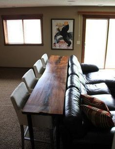 Add a bar to eat at behind the couch. Cool for a basement... More seating to watch hockey!
