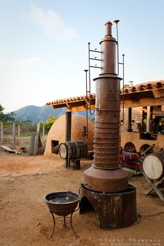 """""""Tequila Distillery""""- Tequila distillery and earthen agave oven used in the tequila making process near San Sebastian, Jalisco, Mexico 