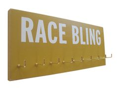 Medals display for your race bling. $28.00, via Etsy.