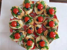 """'Ladybug' Bruschetta: """"Base is made up of sliced baguettes, cream cheese, smoked salmon, and flat-leafed parsley. Sprinkle ground black pepper on tomato, and using a toothpick, dot some cream cheese on the olives for the eyes."""" (image/recipe via @NaomiOig) cherri, smoked salmon, sandwich, tomato, food, oliv, bug, snack, parti"""