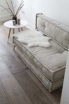 slip cover 2 twin mattresses and stack. mount back to the wall. Couch or two guest beds. canapé gris - do this with crib mattresses for a smaller version