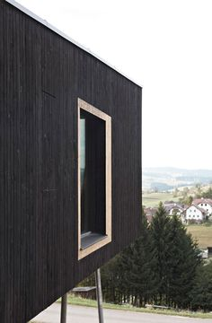 This black wooden house in Austria by Hammerschmid Pachl Seebacher Architekten is raised off the ground on wonky metal stilts to frame views of the landscape and allow room underneath for a sheltered garden black data, austrian mountain, wooden houses, arquitectura, scandinavian design, frames, gardens, architecture, fascin exterior