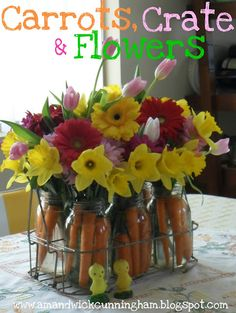 DIY Cute Centerpiece...glass jar filled with fresh flowers & carrots!!  Easy & colorful for your spring get-to-gethers.