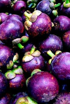 Mangosteen, tropical fruit from Southeast Asia.  MY FAVORITE FRUIT!!!!