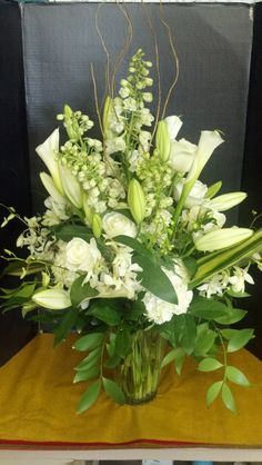 All white arrangement with curly willow