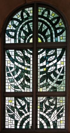 Tree of Life stained glass, Sweden. By Håkan Svensson. Via Wikimedia Commons.