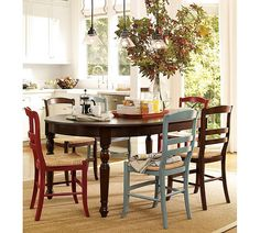 Fun dining room. Love the different colored chairs!