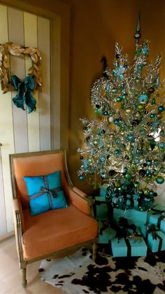blue and green vintage ornaments on this mod tinsel tree