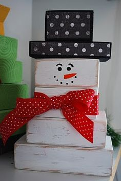 Snowman~ made out of 2 X 4 wood. Cute winter craft!