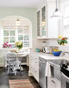 #KitchenRemodel: Pale green walls and slate floors bring the outdoors in—and the revamped layout makes the kitchen feel twice as big, although no significant square footage was added.