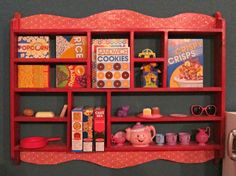 Love how this blogger turned an old oak shelf from Goodwill into fresh, fun storage for the playroom!